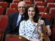 A documentary chronicles former DSO violinist Ann Strubler's search for her birth family. She's seen here with husband Dave.