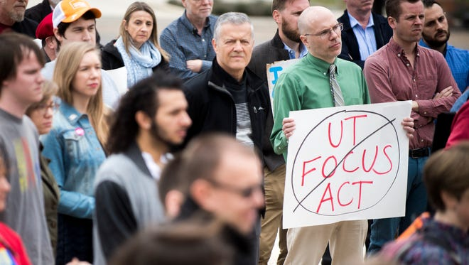 University of Tennessee faculty and staff gather at The Torchbearer on campus for a rally against the UT FOCUS Act on March 20, 2018.