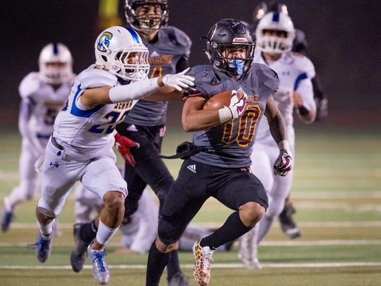 Serra's Chris Park, left, catches Tulare Union's Kazmeir