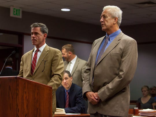 Robert Lyman (right) appears in the 5th District Court
