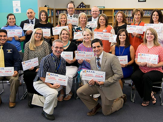 SAISD principals receive checks from the D.E.S.K. organization