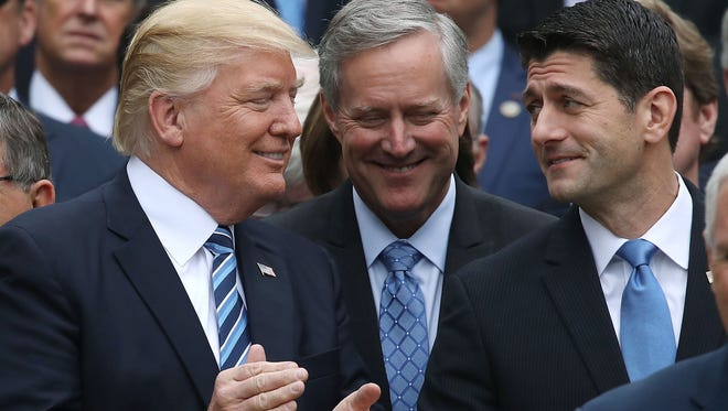 President Donald Trump and House Speaker Paul Ryan gather with other Republicans in the White House's Rose Garden after their version of the health care bill passed the House.