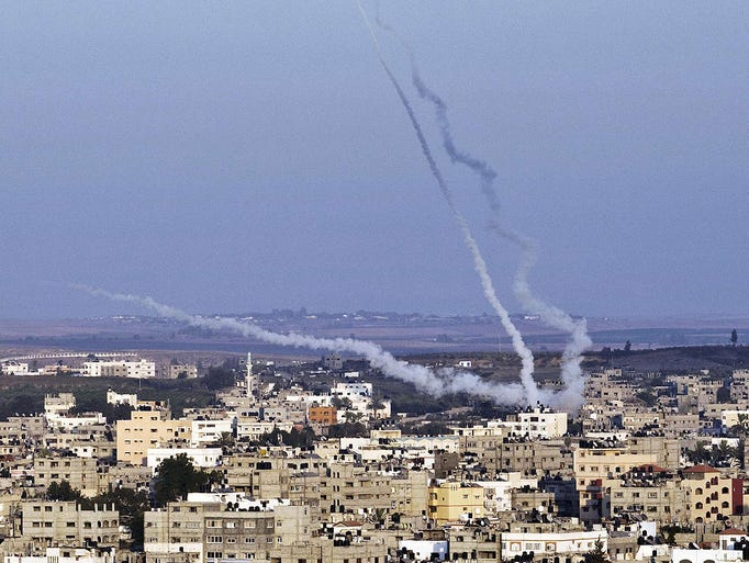 Palestinian militants fire missiles at Israel on Aug. 21 in Gaza City.