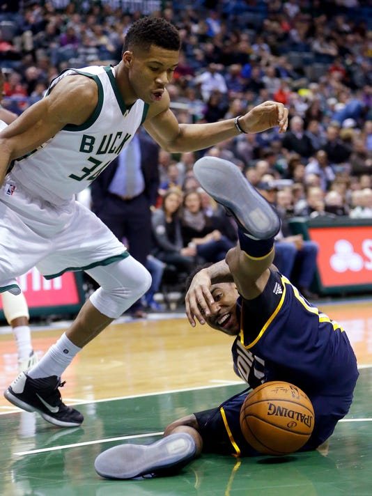 Indiana Pacers' Jeff Teague, right, loses control of the ball next to Milwaukee Bucks' Giannis Antetokounmpo (34) during the first half of an NBA basketball game Friday, March 10, 2017, in Milwaukee. (AP Photo/Aaron Gash)