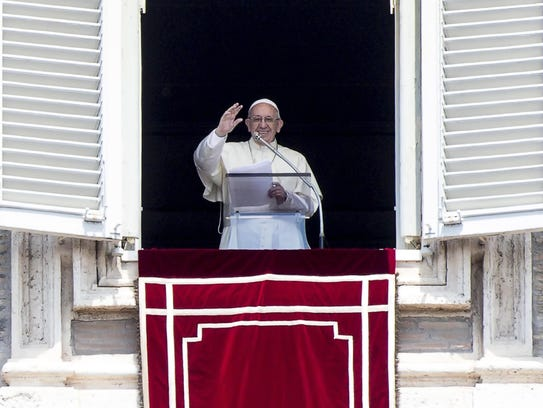 Pope Francis blesses the faithful  from the window