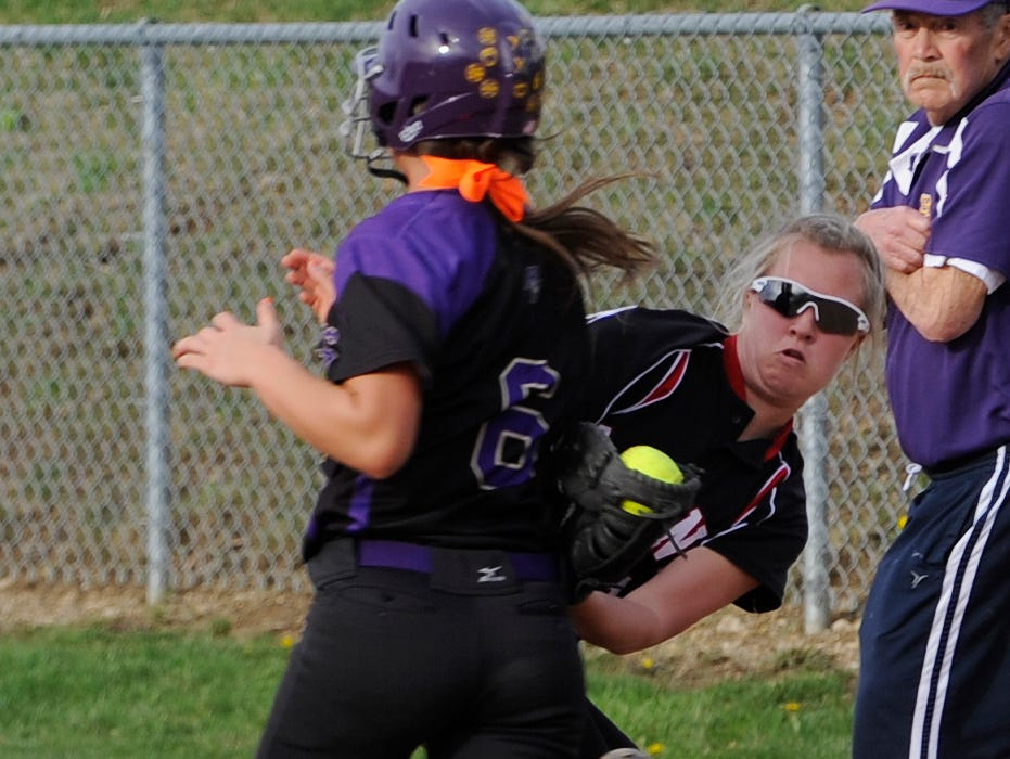 Liberty Union's Cera Maraugha tags out Bloom-Carroll's Kipley Detwiler at Bloom-Carroll High School. The Lions defeated the Bulldogs 1-0 on Wednesday afternoon.