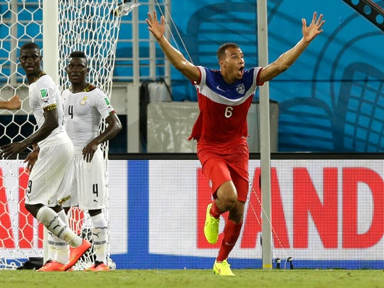 United States' John Brooks celebrates after scoring his side's second goal during a group G World Cup soccer match on Monday. The United States won the match 2-1.