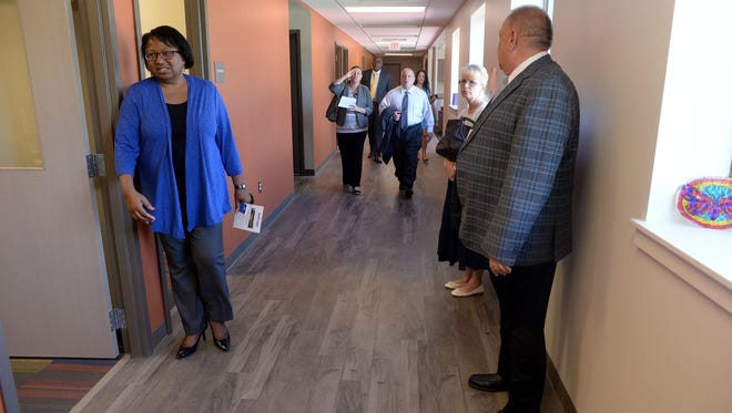 Audrey Carter, executive director of Hendricks House (left), tours the new Daytop New Jersey building in Pittsgrove.