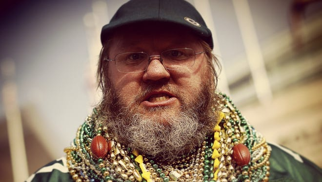 Russell Beckman of Racine wears a pile of beads around his neck in support of his Green Bay Packers.