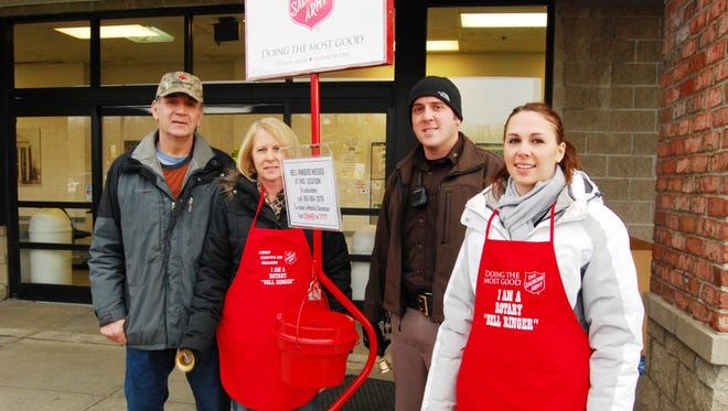 Howard Biscarner, left, Toni Biscarner, Joe Biscarner and Stephanie Dombrowski were ringing the bell outside Neiman's Family Market in St. Clair for the Salvation Army Red Kettle campaign.