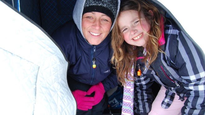 Tina Underwood, of Clay Township, and her daughter, Jacklyn, were fishing on Lake St. Clair's Bouvier Bay