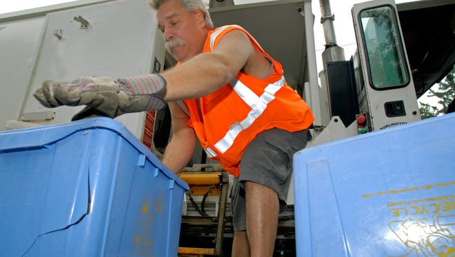 Randy Chagnon, 51, of Burlington, picks up recycling on his route through neighborhoods in the new North End