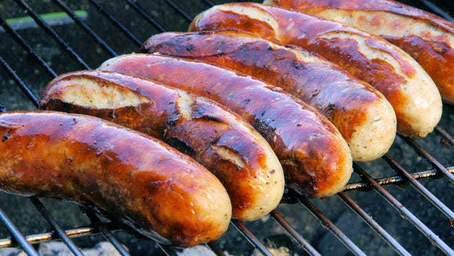 Bratwursts on the grill.