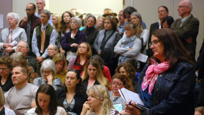 A packed public hearing is held Monday, Oct. 16, 2017, in Santa Fe, N.M., on a proposed overhaul of New Mexico's state science standards for public schools.