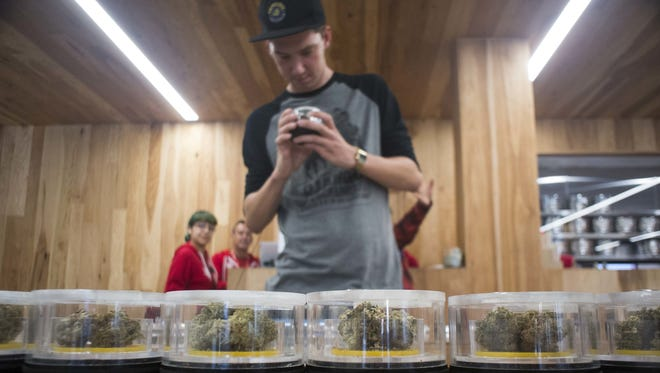 Parker McMillan shops at MedMen in West Hollywood on Jan.1, when California's legal pot market opened.