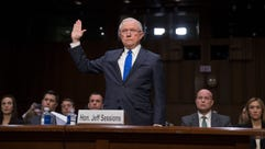 Attorney General Jeff Sessions is sworn in to testify
