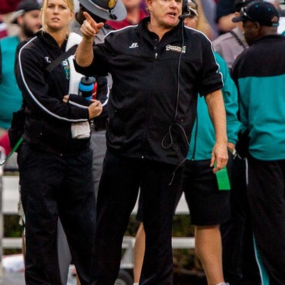 Nov 23, 2013; Columbia, SC, USA; Coastal Carolina Chanticleers head coach Joe Moglia directs his team against the South Carolina Gamecocks in the second half at Williams-Brice Stadium. Mandatory Credit: Jeff Blake-USA TODAY