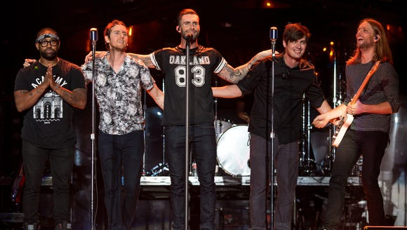 The members of Maroon 5, from left: PJ Morton, Mickey