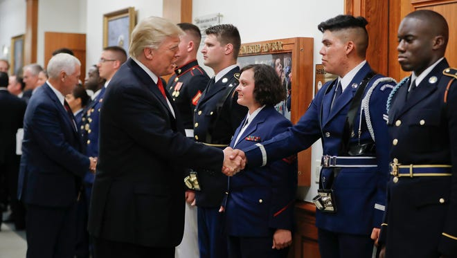 President Donald Trump and Vice President Mike Pence greet military personnel during their visit to the Pentagon, Thursday, July 20, 2017.
