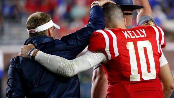 Ole Miss QB Chad Kelly (10) apologized to Hugh Freeze for running onto the field and being restrained at his younger brother's high school game last week.