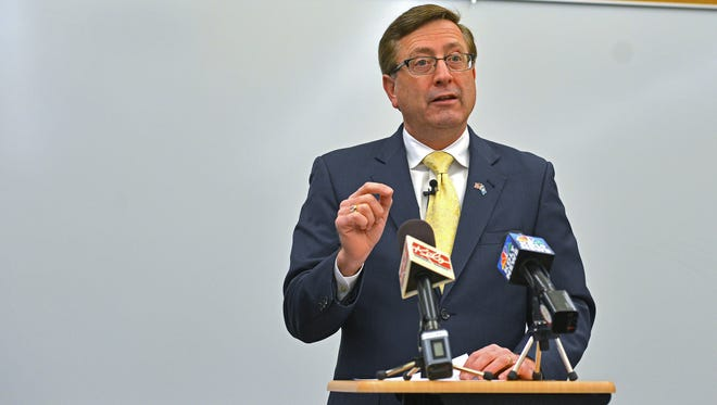 Sioux Falls mayor Mike Huether speaks during a press conference at the Downtown Branch of the Siouxland Libraries in Sioux Falls.