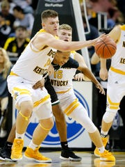 Northern Kentucky Norse forward Drew McDonald (34) takes the ball away from Wright State Raiders guard Jaylon Hall (0) as they collide in the first half of the NCAA basketball game between the Northern Kentucky Norse and the Wright State Raiders at BB&T Arena in Highland Heights, Ky., on Thursday, Jan. 11, 2018.