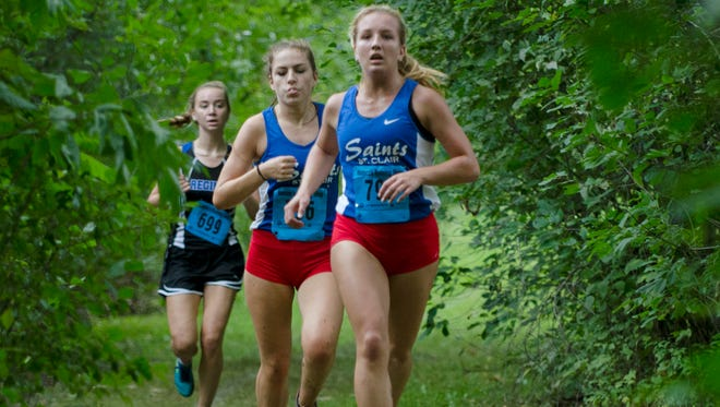 St. Clair's Morgan Markel leads a pack including her teammate Gabrielle Morton, right, Saturday, Sept. 10 at the Algonac Muskrat Cross Country Classic at Algonac High School. Markel finished second with a time of 20:18 and Morton finished first with a time of 20:12