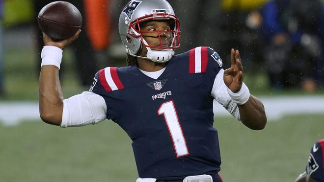 New England Patriots quarterback Cam Newton passes during the Patriots' win over the Baltimore Ravens on Sunday. Newton is third in the NFL with nine rushing touchdowns.