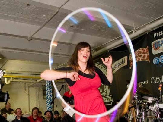 2012: A Sausage Queen contestant performs with a lighted hula hoop at Bockfest Hall.