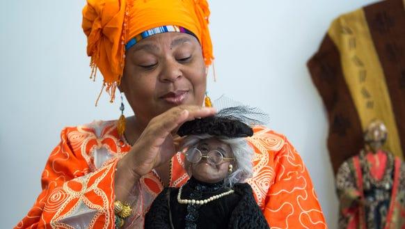 Karen 'Queen Nur' Abdul-Malik adjusts the hat atop
