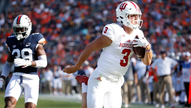 Indiana Hoosiers quarterback Peyton Ramsey (3) scores a touchdown in front of Virginia Cavaliers safety Chris Moore (39) during the second quarter at Scott Stadium.