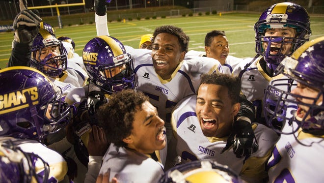 Waynesboro players celebrate together after defeating Hidden Valley during their Group 3A first round playoff football game on Friday, Nov. 14, 2014.
