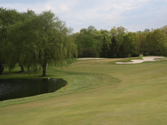 The approach shot at hole No. 2 at Travis Pointe Country Club in Ann Arbor.