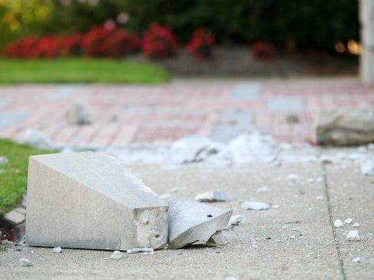 Large chunks of stone rest on the ground after falling from St. Thomas the Apostle church along 4th and Bancroft Streets in Wilmington after an earthquake was felt in Delaware on Aug. 23, 2011.