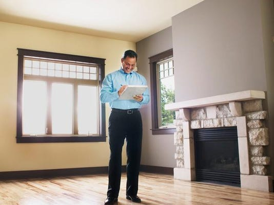 Man taking notes in empty house