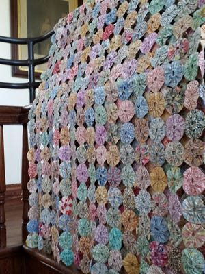 The quilt collection features examples from the past mid-century.