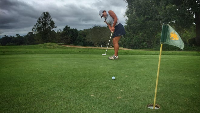 Aucilla Christian freshman Megan Schofill putts at Killearn Country Club. Schofill finished second at the Big Bend Championship and is averaging 38.7 strokes per nine holes.
