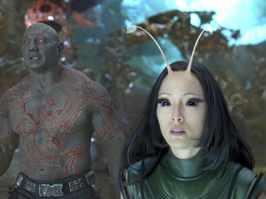"This image released by Disney-Marvel shows David Bautista, left, and Pom Klementieff in a scene from, ""Guardians Of The Galaxy Vol. 2."" (Disney-Marvel via AP)"