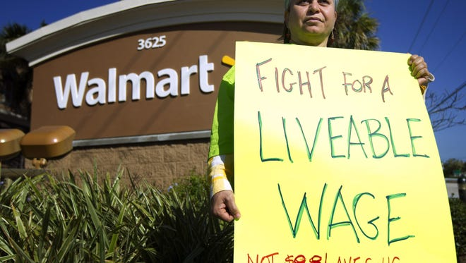 Walmart workers have held protests to call for higher wages. (AP Photo/J Pat Carter)