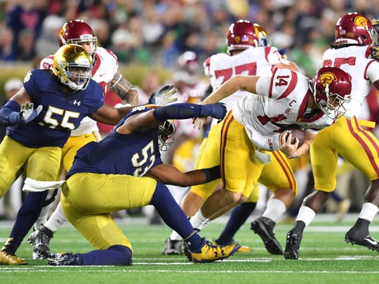 USC quarterback Sam Darnold (14) is sacked by Notre Dame Fighting Irish defensive lineman Khalid Kareem (53), Oct. 21, 2017.