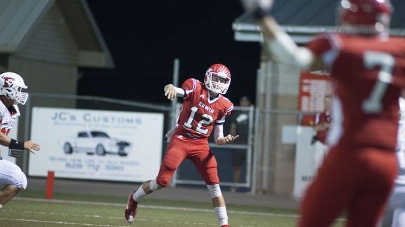 Erwin's Damien Ferguson throws a pass to Chase Austin