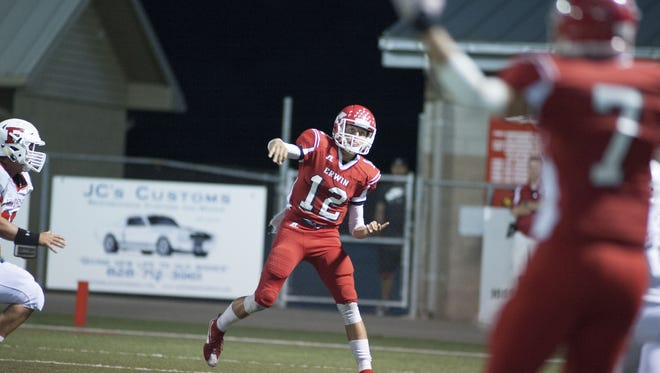 Erwin's Damien Ferguson throws a pass to Chase Austin on Friday night.