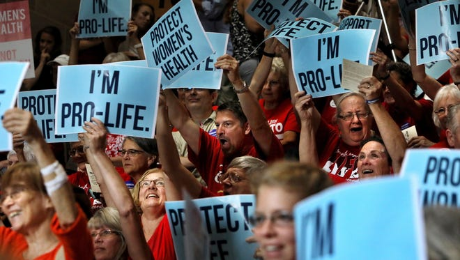 People cheer during an anti abortion rally in the Statehouse in Jefferson City, Mo., Wednesday, June 14, 2017. Missouri Republican Gov. Eric Greitens is leading a Capitol rally to show support for a special session he called on abortion. (David Carson/St. Louis Post-Dispatch via AP)