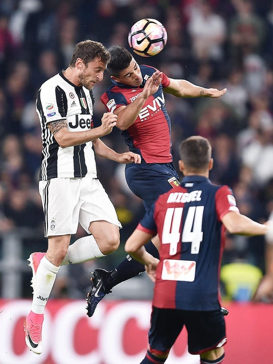Juventus' Claudio Marchisio, left, and Genoa's Giovanni Simeone jump for an header during the Italian Seria A soccer match between Juventus and Genoa at the Juventus stadium in Turin, Italy, Sunday, April 23, 2017. (Alessandro Di Marco/ANSA via AP)