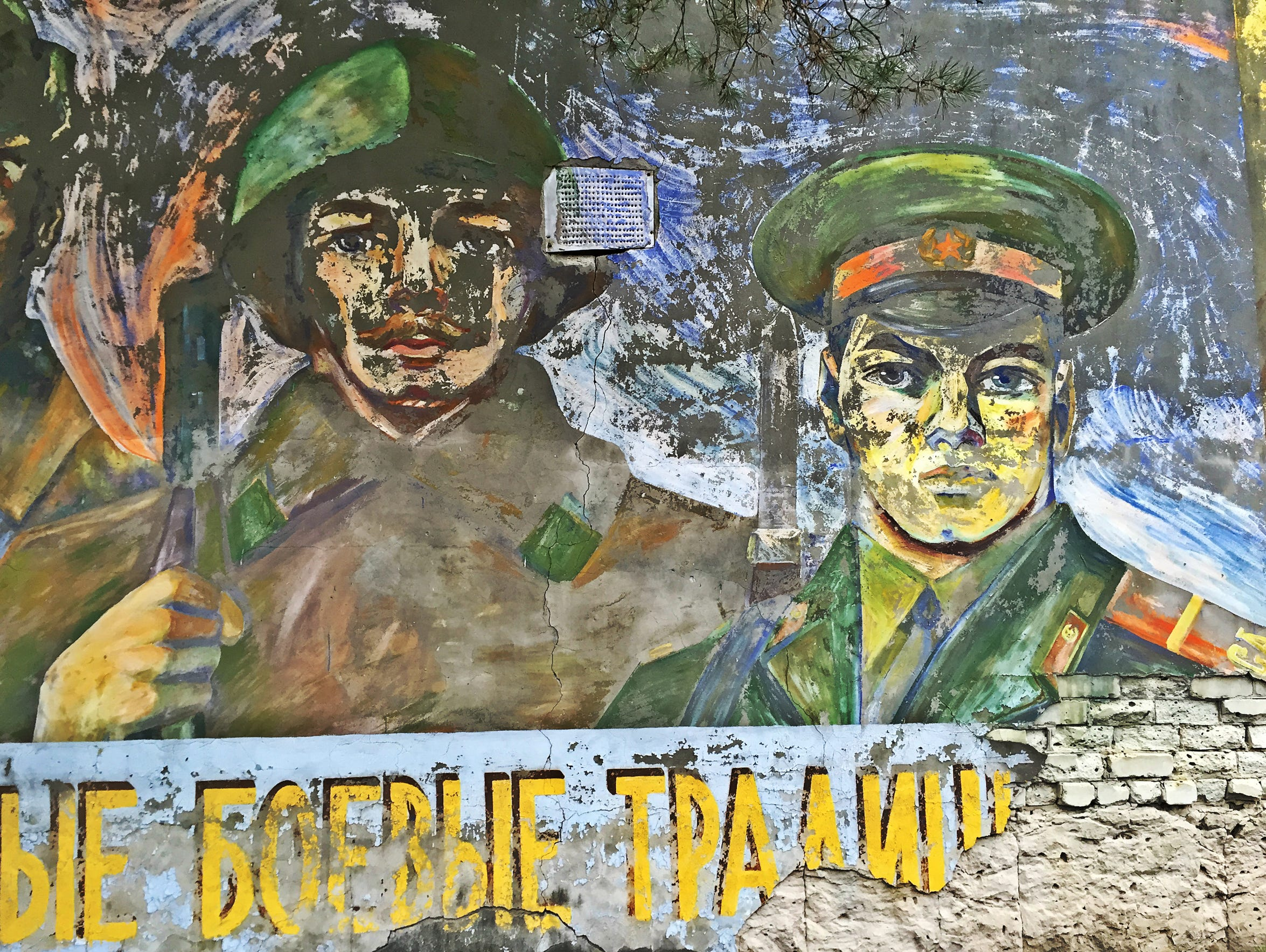 A mural featuring soldiers in Chernobyl's Exclusion