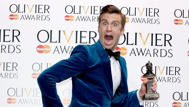 Gavin Creel, winner of the best actor in a musical award for 'The Book Of Mormon,' leaps at the Laurence Olivier Awards at The Royal Opera House on April 13, 2014 in London.