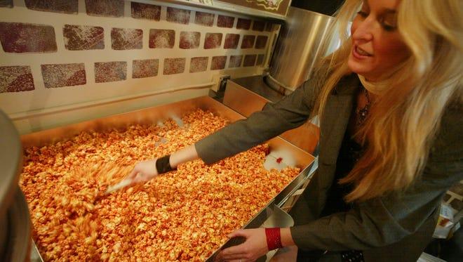 Just Pop In! co-owner Mandy Selke mixes a batch of cinnamon-caramel popcorn.