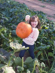 Suzanne Jones with pumpkin at Stony Hill Farms in Chester