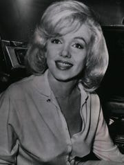 Marilyn Monroe smiles as she leaves Columbia-Presbyterian