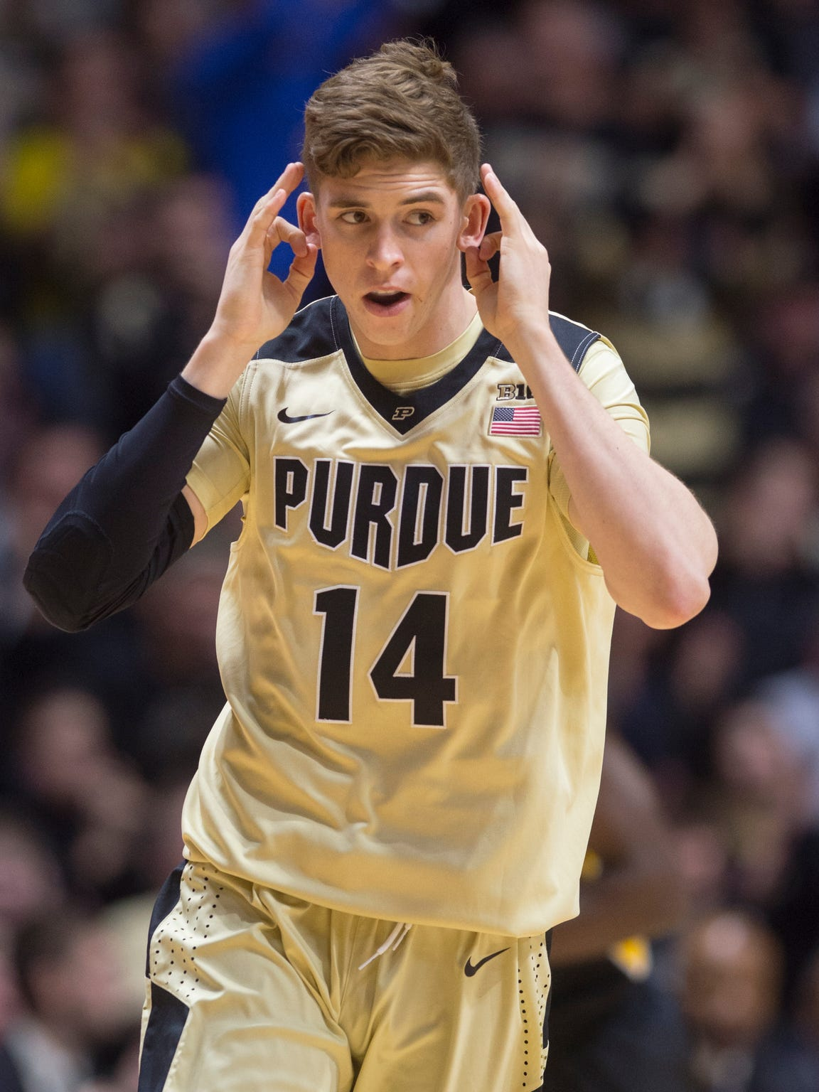 Purdue guard Ryan Cline reacts after hitting a 3-point